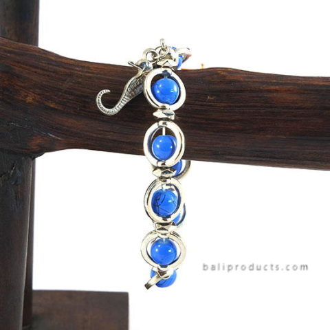 Blue Bead Inside Round Metal with Charm
